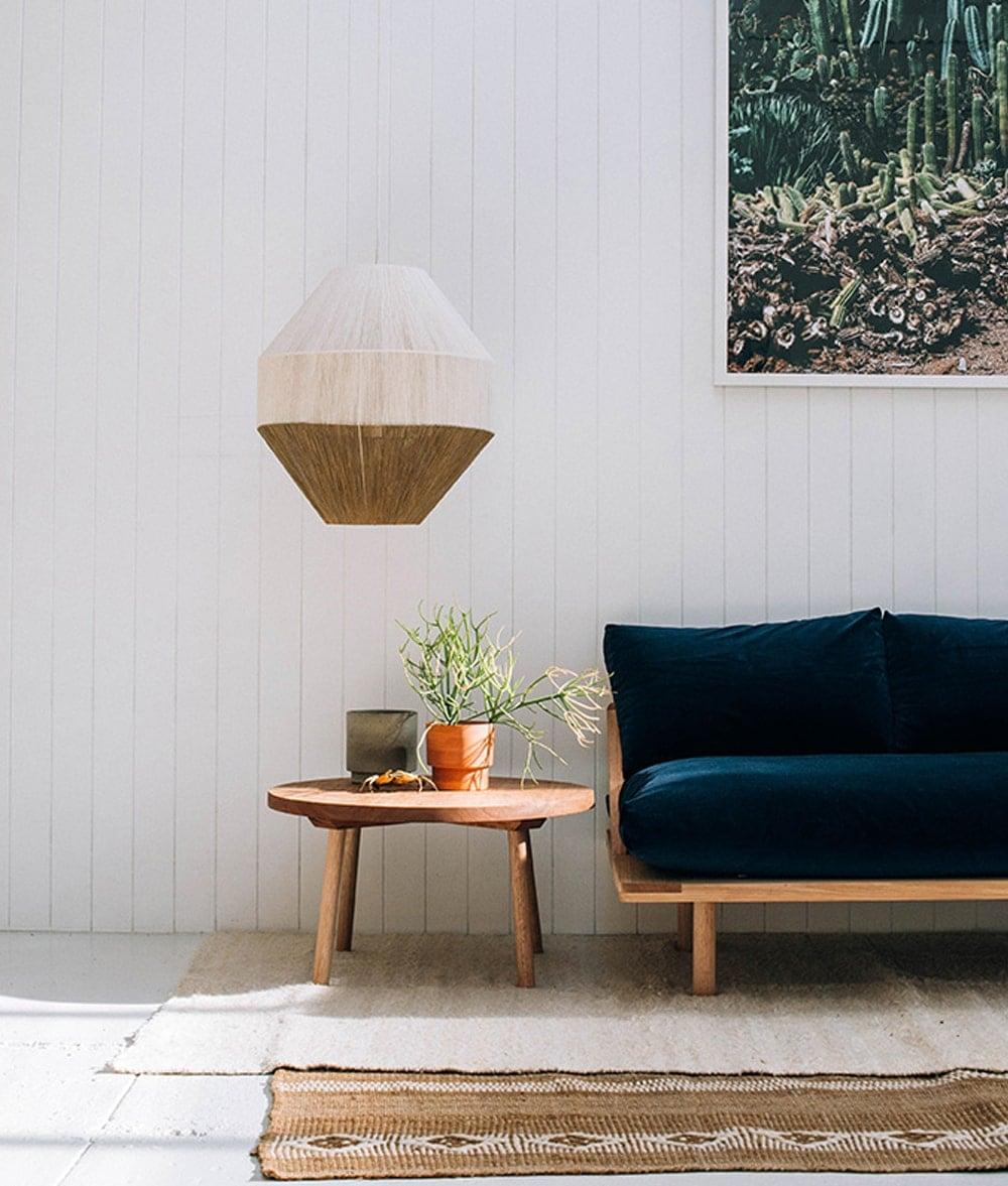 midnight blue velvet sofa | cacti | side table