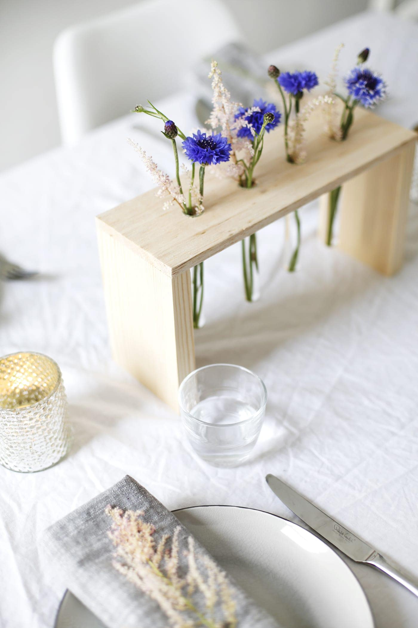DIY floral table centre made with wood and test tubes | easy craft tutorial perfect for entertaining | home tutorial ideas