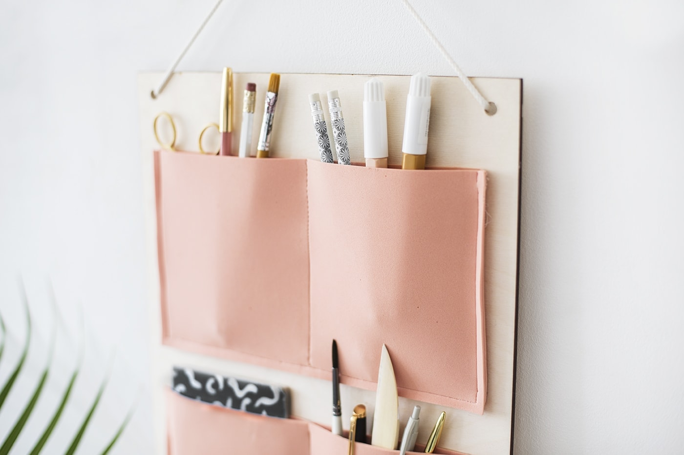 DIY hanging organiser made with plywood and foam pockets | organisation | easy craft ideas for the home or office